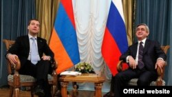 Russian President Dmitry Medvedev (left) meets his Armenian counterpart, Serzh Sarkisian, in St. Petersburg