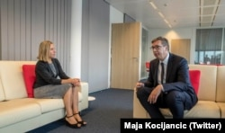 EU foreign policy chief Federica Mogherini (left) speaks with Serbian President Aleksandar Vucic in Brussels on September 7.