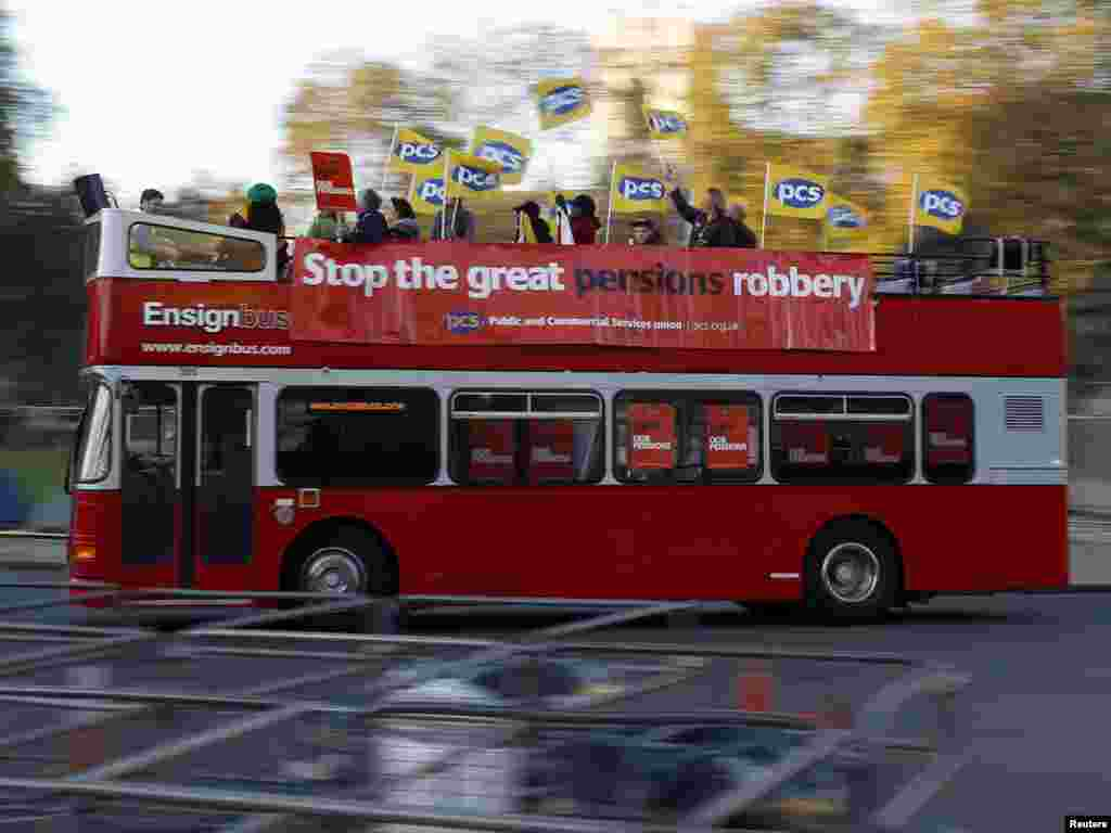 A bus carrying union members drives through Parliament Square in central London on November 30 during that country's first mass strike in some 30 years. (REUTERS/Stefan Wermuth)