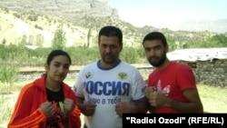 FILE: Tajik boxer Mavzuna Chorieva with her trainer Balanov.