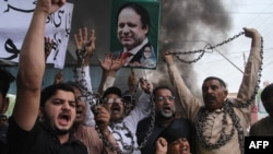 Supporters of Pakistan Muslim League-Nawaz (PML-N) chants slogans after the sentencing decision against former prime minister Nawaz Sharif, during a protest in Multan on July 7.