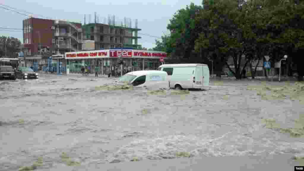 Flooding hits the town of Gelendzhik, where two months of rain is reported to have fallen in 24 hours.