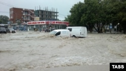 Flooding hits the Black Sea resort town of Gelendzhik on July 7, where nine people were reported dead.