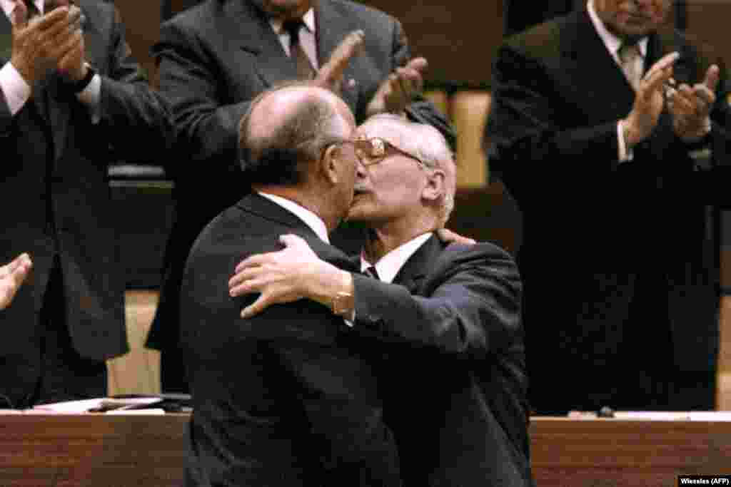 Three years before the Berlin Wall came down, Honecker grips Gorbachev tight during the latter's state visit to East Germany in 1986.