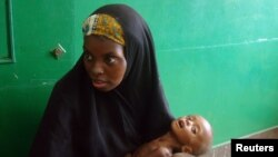 A woman holds a malnourished baby in the Somali capital, Mogadishu.