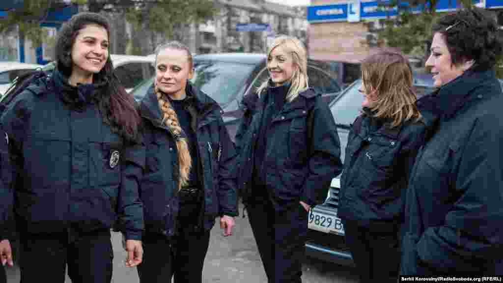 Ukrainian policewomen finish their night shifts early on March 8.