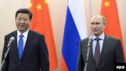 Россия Президенти В.Путин (ў) ва Хитой Президенти С.Цзиньпин, 2014 йил 6 февраль, Сочи.
