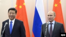 Russian President Vladimir Putin (right) with his Chinese counterpart Xi Jinping in Sochi on February 6.
