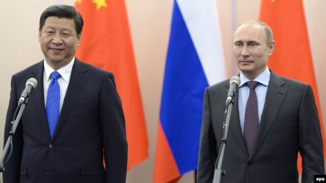 Russian President Vladimir Putin (right) is scheduled to hold talks with Chinese President Xi Jinping in Shanghai on May 20.