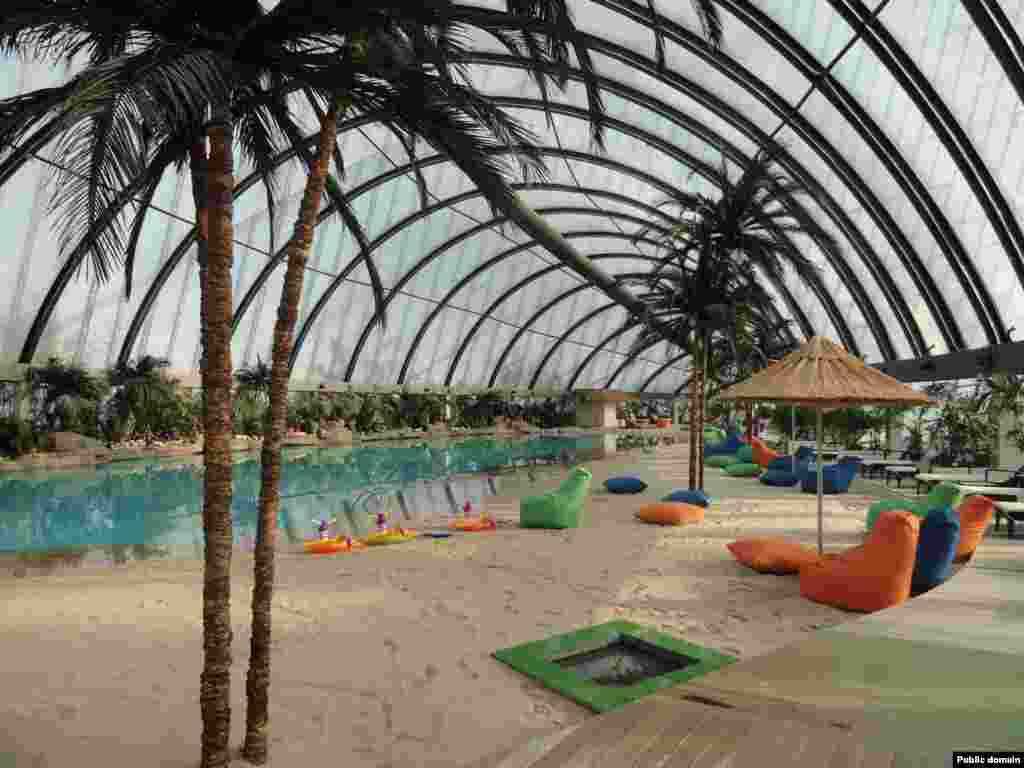 Inside the Khan Shatyr, an artificial beach stocked with sand from the Maldives awaits paying bathers. The extravagance of the new structures caused controversy in a country where the average annual household income around the time of Astana's construction was less than $600.