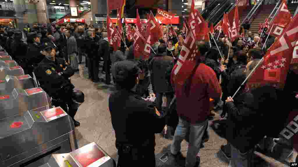 Workers demonstrate during a general strike at the Atocha train station in Madrid, Spain.
