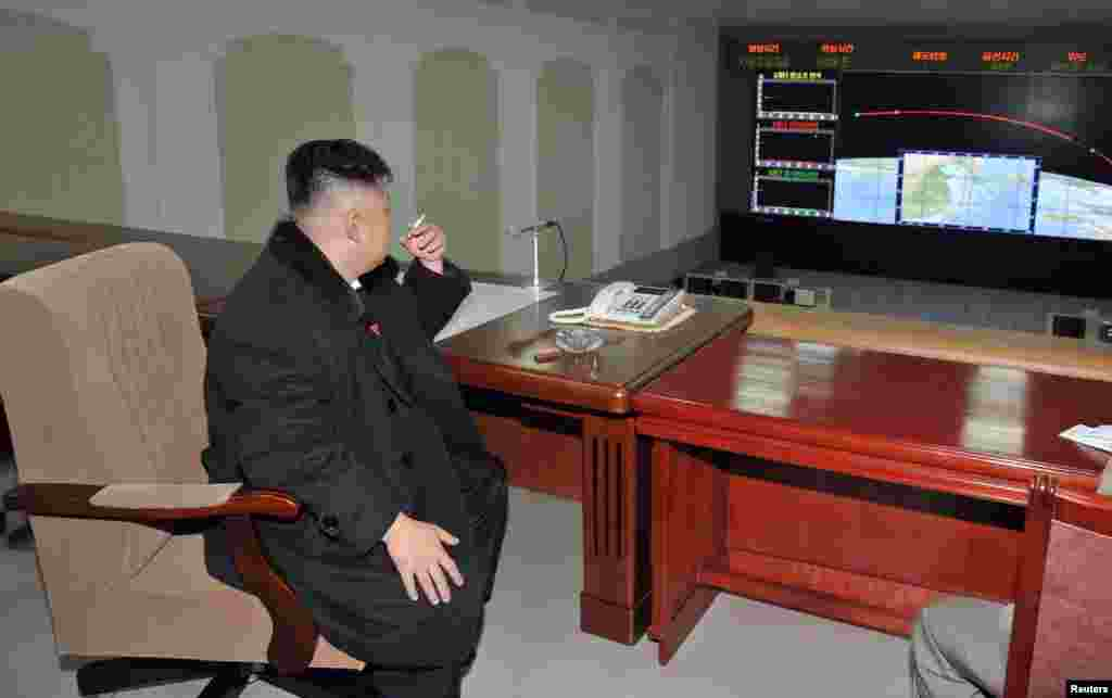 North Korean leader Kim Jong Un smokes a cigarette while monitoring events at the General Satellite Control and Command Center after the launch of the Unha-3 rocket that carried a satellite into polar orbit on December 12. (Reuters/KCNA News Agency)