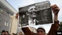 A man holds a sign investing hope in U.S. President Barack Obama at a Georgian opposition rally in Tbilisi in November 2008.