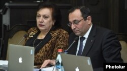 Armenia - Newly appointed Economy Minister Artsvik Minasian (R) attends his first cabinet meeting, Yerevan, 25Feb2016.