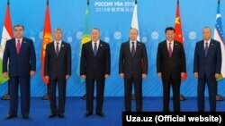Uzbekistan - Uzbek state agency family photo of SCO presidents, 15 July 2015