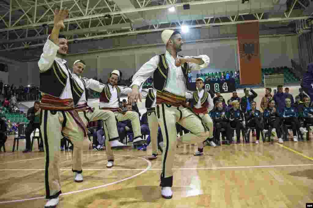 Kosovar Albanians dressed in traditional clothes celebrate after the Football Federation of Kosovo (FFK) was accepted as the 55th member of UEFA, European soccer's governing body, at a sports hall in Mitrovica, Kosovo. (epa/Valdrin Xhemaj)