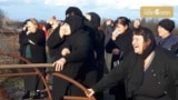 Screen grab for this video https://www.rferl.org/a/georgia-abkhazia-bridge-mourners/29785244.html
