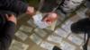 Алдын ала белгиленген банкноттор. Бишкек. 22-февраль, 2021-жыл. (Сүрөт УКМКга таандык).