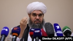 Taliban negotiator Shahabuddin Delawar addresses a press conference in Moscow on July 9.