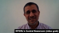 Former Iranian President Ahmadinejad in an interview with RFE/RL