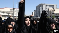 Iranian protestors shout slogans during a demonstration against Saudi Arabia in Tehran after 131 Iranians pilgrims were killed in a stampede at the annual hajj, on September 25,