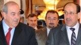 المالكي وعلاوي خلال لقاء في بغداد تموز 2010