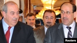 Former Prime Minister Nuri al-Maliki (right) with the head of Al-Iraqiyah, Iyad Allawi