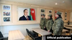 Azerbaijan - Defense Minister Zakir Hasanov (C) visits an Azerbaijani army base.