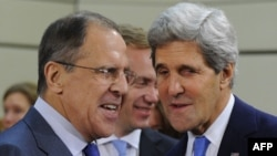 Russian Foreign Minister Sergei Lavrov (left) speaks with U.S. Secretary of State John Kerry