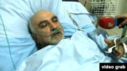 Candidate Paruyr Hairikian lies in a Yerevan hospital on February 1 after he was shot and wounded.