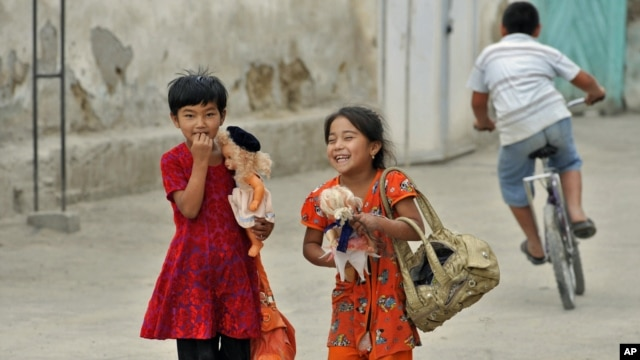 Ethnic Uzbek girls walk along a street just outside the southern city of Osh in June.