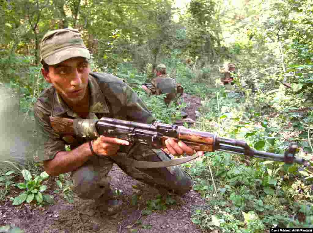 "Georgian soldiers training near the Pankisi Gorge in 2002. The gorge was notorious at the time for harboring often foreign-born Islamic militants. Georgian security forces reportedly captured ""more than a dozen Arab militants"" in Pankisi in 2002."