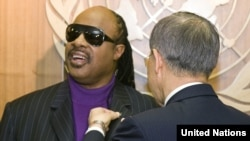 UN Secretary-General Ban Ki-moon appoints Stevie Wonder as a messenger of Peace at UN headquarters in New York.