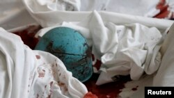 The helmet of a dead antigovernment protester lies on bloody sheets in the lobby of the Hotel Ukraine.