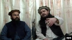 Hakimullah Mehsud (right), chief of Tehrik-e Taliban Pakistan, sits with Waliur Rehman, his deputy, during a video recording at an undisclosed location near the Pakistani-Afghan border.