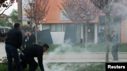 Kosovo -- Protesters firing tear gas disrupt the inauguration ceremony for new President Hashim Thaci in Pristina, April 8, 2016