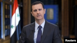 Президент Сирии Башар Асад во время интервью венесуэльскому телеканалу TeleSUR. Дамаск, 25 сентября 2013 года.