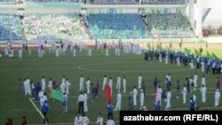 """When the president appears in the stadium, everyone will stand up and say the following, 'My beloved country Turkmenistan and glory to the Protector.' Let's practice it!"""
