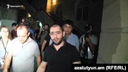 Armenia - Hayk Sarkisian (in a black T-shirt), son of Aleksandr Sarkisian and nephew of Armenia's ex-president Serzh Sarkisian, accompanied by investigators near his Yerevan apartment, July 4, 2018
