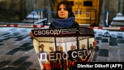 "A single-picket protester in Moscow holds a poster in support of a group of men who were given lengthy prison sentences in a case known as ""the Network."" The verdicts against the men who were found guilty of terrorism charges has drawn widespread criticism both in Russia and abroad."