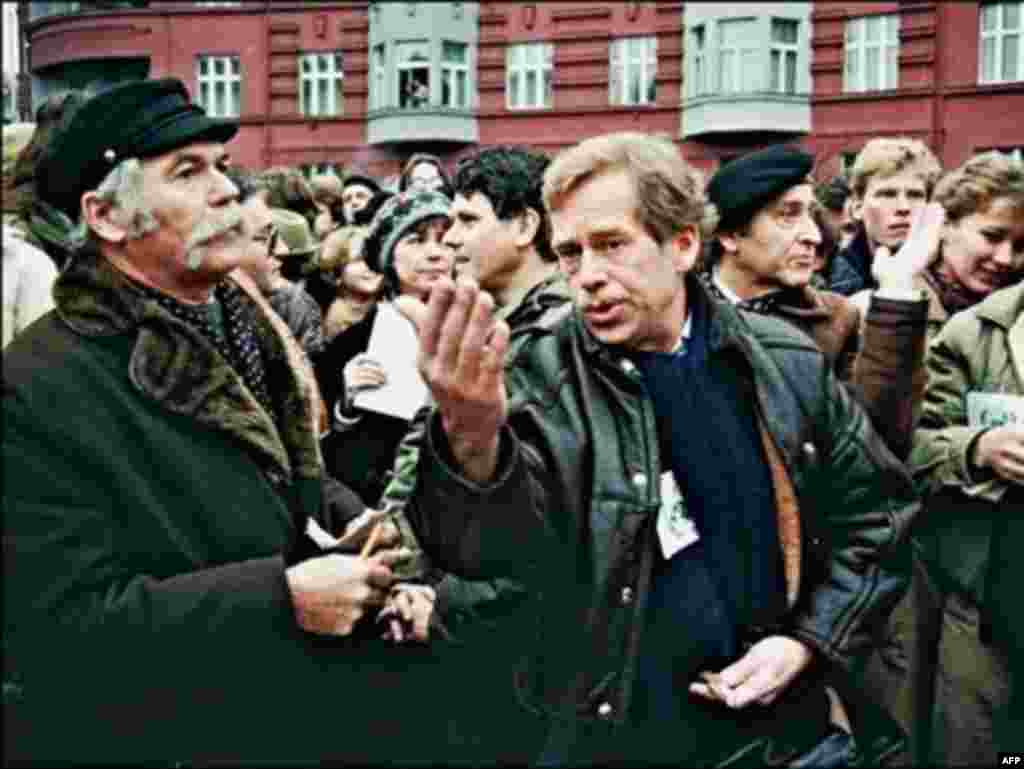 Havel (right) addresses a crowd of demonstrators celebrating the 40th anniversary of the Universal Declarations of Human Rights in Prague on December 10, 1988.