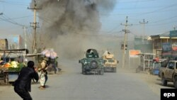 Smoke billows from the scene of a suicide bomb attack in the northern Afghan province of Kunduz on February 10.
