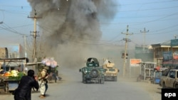 Smoke billows from the scene of a suicide bomb blast in Kunduz in February.