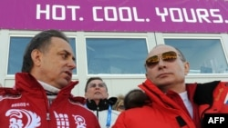 """Russian President Vladimir Putin (right), shown here with Sports Minister Vitaly Mutko (left) at the 2014 Winter Olympics, has said the banned drug meldonium """"has nothing to do with doping."""""""