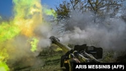 NAGORNO KARABAKH -- An Armenian soldier fires artillery on the front line on October 25, 2020.
