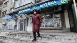 Kazakhstan. COVID-19 the Woman leaves the pharmacy. Almaty, December 9, 2020