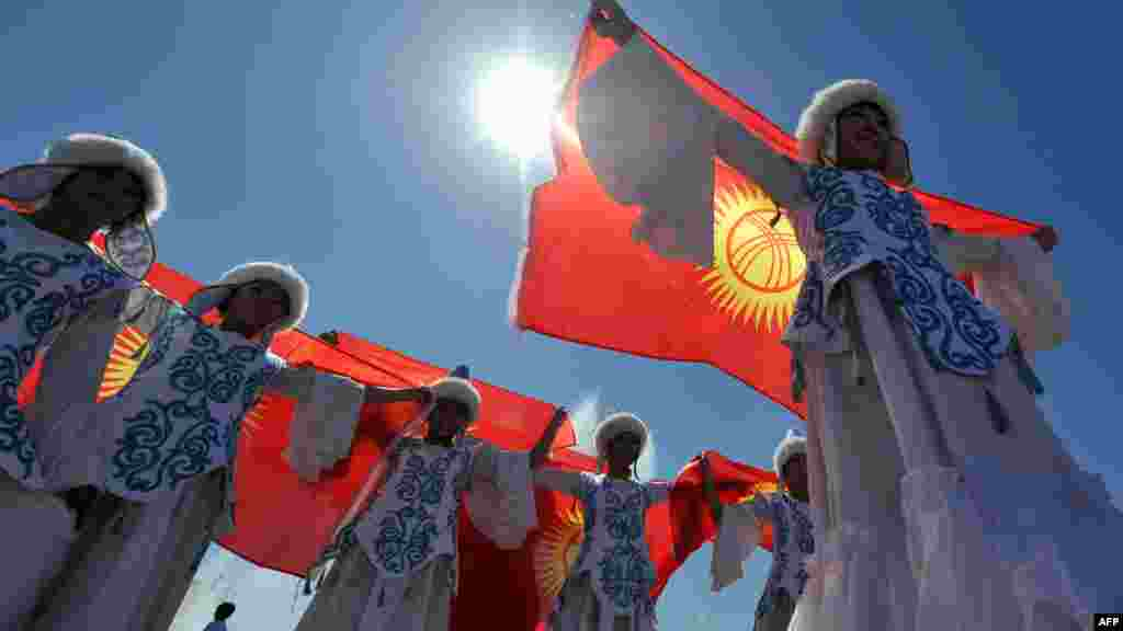 Young Kyrgyz girls wear traditional costumes and dance on Ala-Too Square in Bishkek on Kyrgyz Independence Day. (AFP PHOTO/Vyacheslav Oseledko)