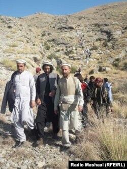 Nadeem Askar (C) and Haji Abdul Samad (L) led a group of volunteers to broker a cease-fire between Khaddi and Machi Khel clans on November 19.