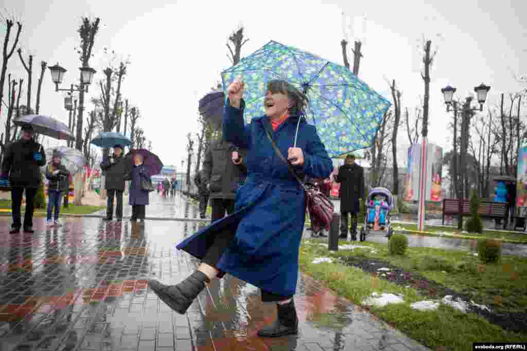 Elderly women marched and sang before the Minsk ceremony. Belarus is the only country of the former U.S.S.R. that marks November 7 as a national holiday.