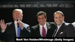 Donald Trump (left to right), Tevfik Arif, and Felix Sater attend the Trump Soho Launch Party in 2007 in New York.